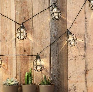 Caged string lights