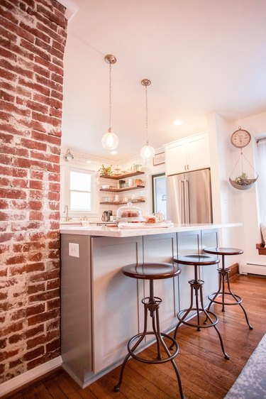 small industrial kitchen with exposed brick post