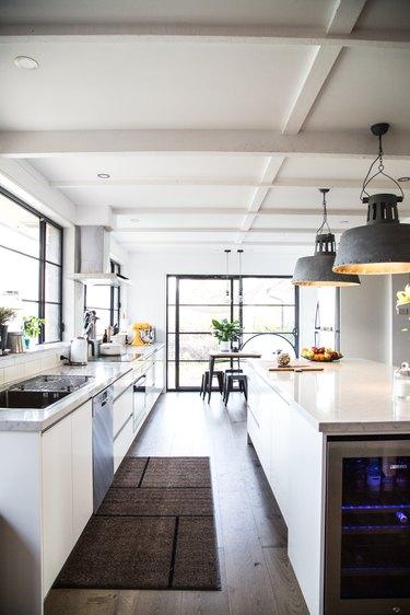 industrial kitchen with oversized metal pendants