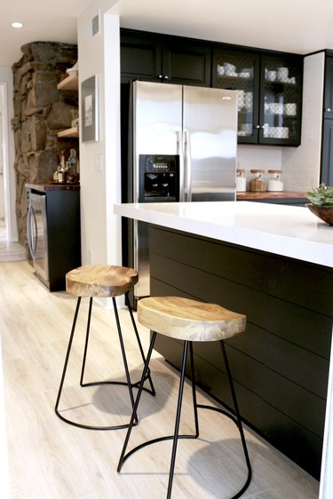 metal and wood bar stools in black industrial kitchen