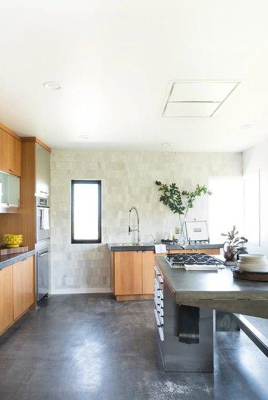 minimalist industrial kitchen with concrete countertops