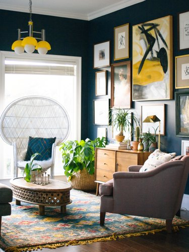 navy blue living room with yellow accents