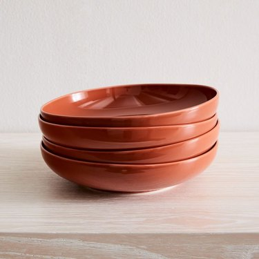 stack of orange plates