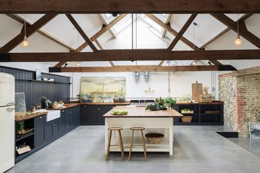 industrial kitchen with concrete floor and wood beams