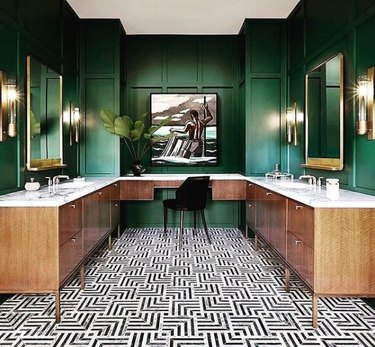 Green painted bathroom with black and white floor