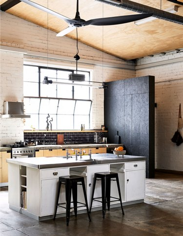 industrial kitchen with high ceilings and oversized fan