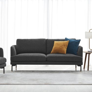 Loveseat in grey with pillows