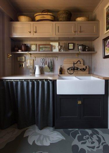 Dark moody kitchen with sleek black curtains