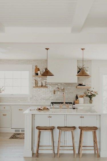 white kitchen with brass hardware