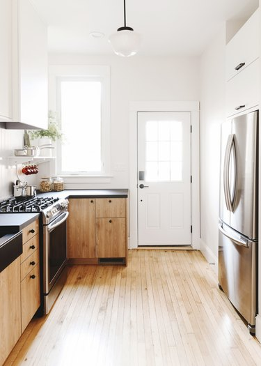 white and wood finish kitchen with black knobs