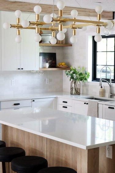 traditional kitchen with modern brass chandelier