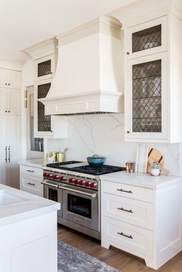 white traditional kitchen with large decorative range hood