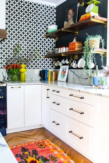 black and white kitchen with black and brass hardware