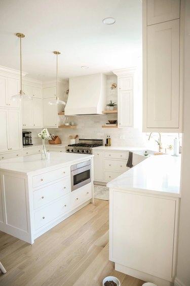 white kitchen with brass knobs
