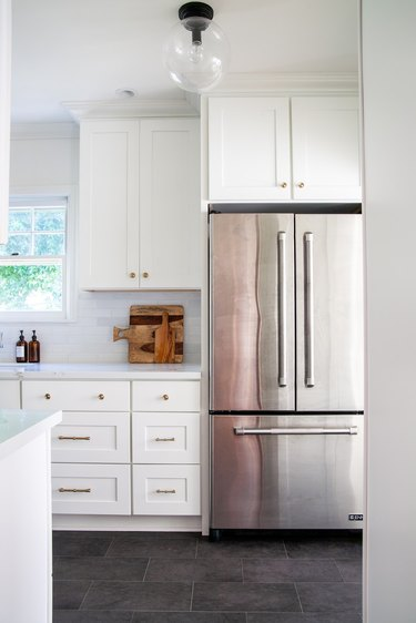 white traditional kitchen with cutting boards on countertop