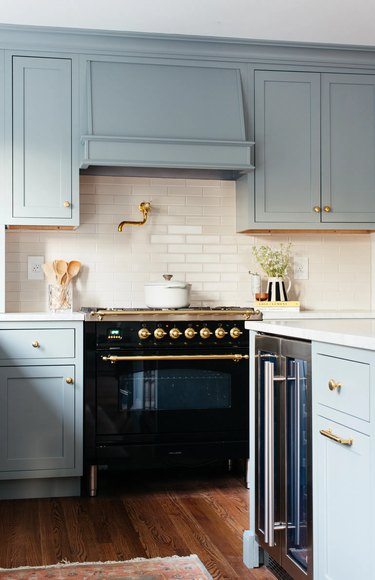 blue kitchen with gold hardware