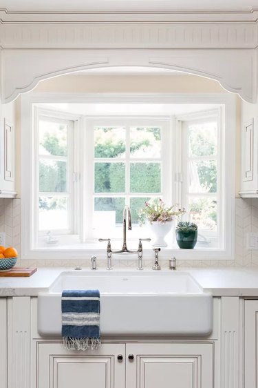 off-white cabinets in traditional kitchen