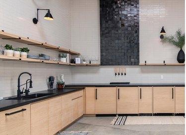white tile backsplash with black vertical tiled component