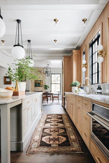 traditional kitchen with wood cabinets and marble countertops
