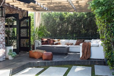 outdoor patio cover with Roman shades