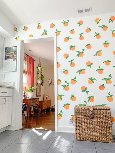 Hand painted oranges on kitchen wall