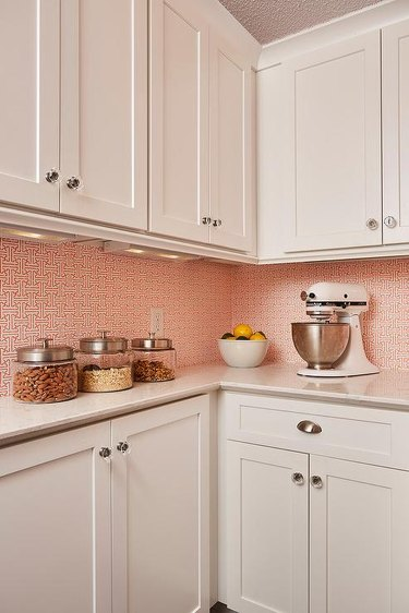 Kitchen pantry with orange and white wallpaper
