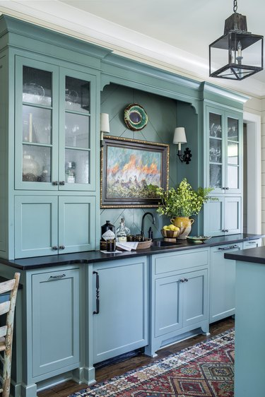 blue-green custom kitchen cabinets and colorful runner