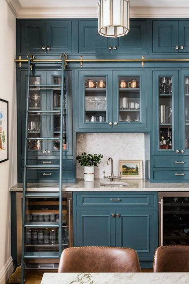 glossy blue kitchen butlers pantry with library ladder