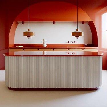 modern orange kitchen by Benjamin Guedj