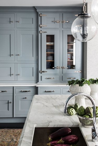 blue grey kitchen cabinets with silver hardware