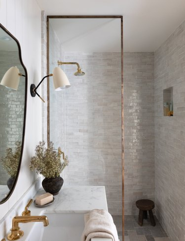 Neutral color palette bathroom by Amber Interiors