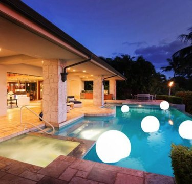Pool with floating globe lights