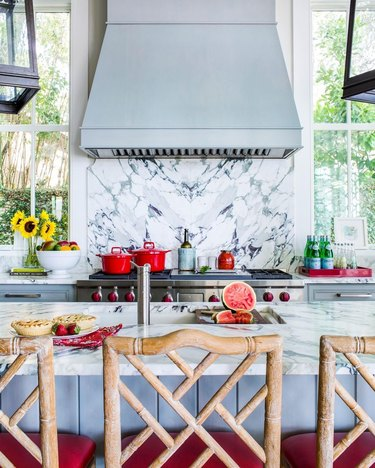 light blue kitchen with red accents