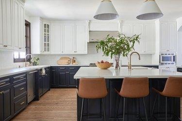 white upper kitchen cabinets and dark blue lower cabinets