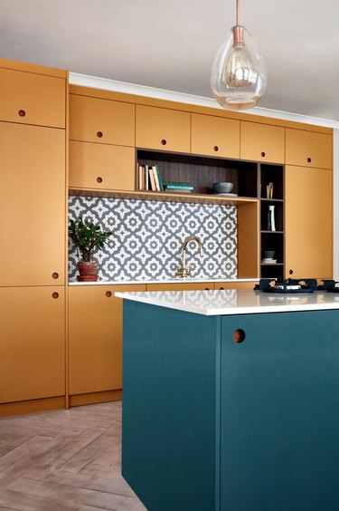 Wall to wall orange kitchen cabinets