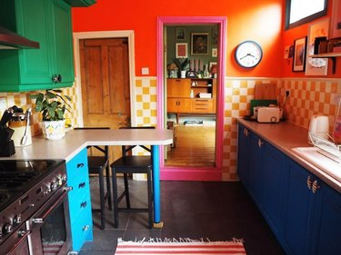 Kitchen with orange and white checkerboard tiles