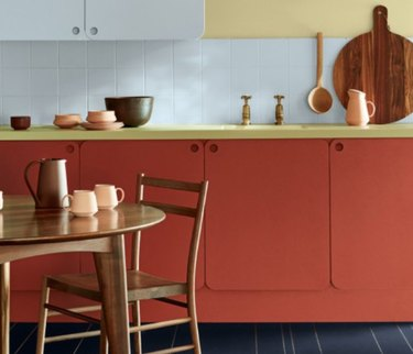 Red kitchen cabinets, table, chairs