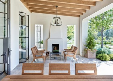 built-in closed roof patio cover with exposed wood beams