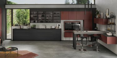 Black and rust kitchen with concrete floors