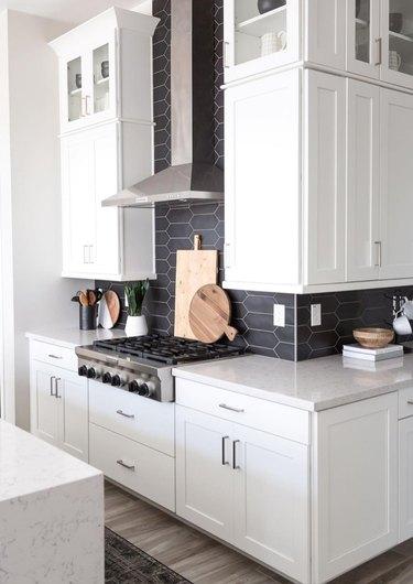elongated black tile backsplash