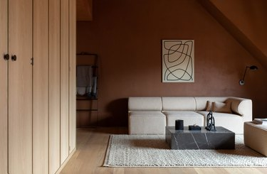 living room with terra cotta wall paint