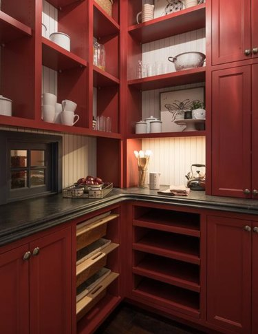 Kitchen with dark red cabinets and shelves