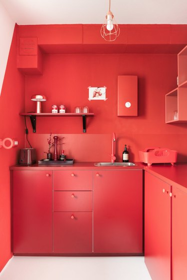 Red kitchen cabinets and walls