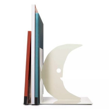 books with white moon crescent bookend