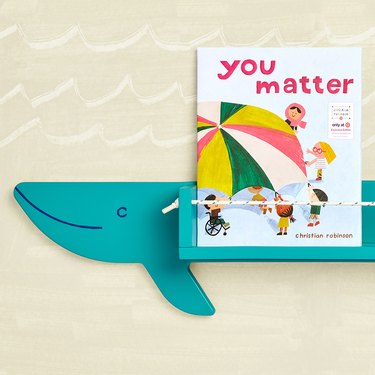 """blue whale-shaped book shelf with book that reads """"you matter"""" as its title"""
