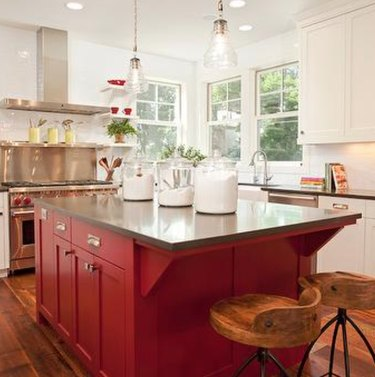 Kitchen with white cabinets and red cabinets