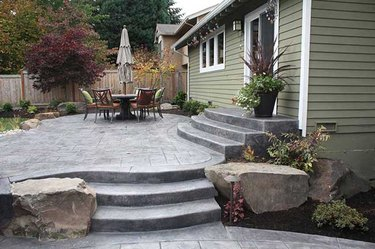 A freeform shaped stamped concrete patio with multiple levels