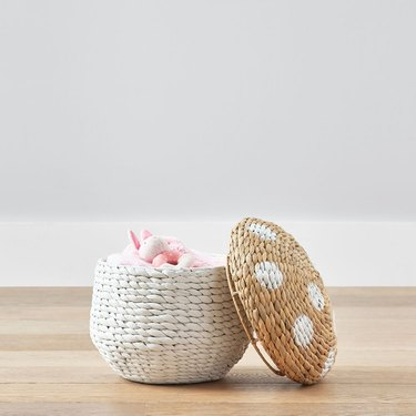small basket with top open, designed to look like a mushroom