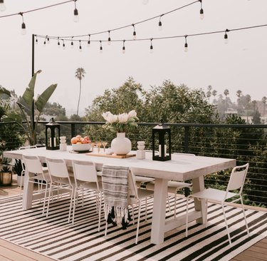 Deck with dining table and string lights