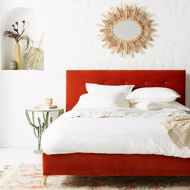 Red bed with white linens